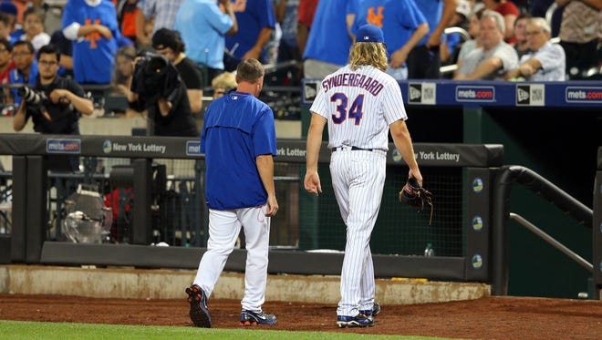 Syndergaard leaves the game during the fifth inning at Citi Field.