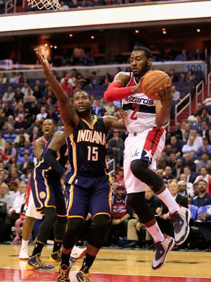 John Wall (2) of the Washington Wizards puts up a shot in front of Donald Sloan (15) of the Indiana Pacers on Nov. 5, 2014, during the first half at the Verizon Center in Washington, D.C.