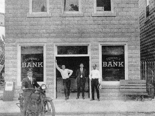 The former 1912 Stuart Bank building served as the Seminole Bank in 1923. John Taylor (2nd from right in a suit) was president of the Seminole Bank.