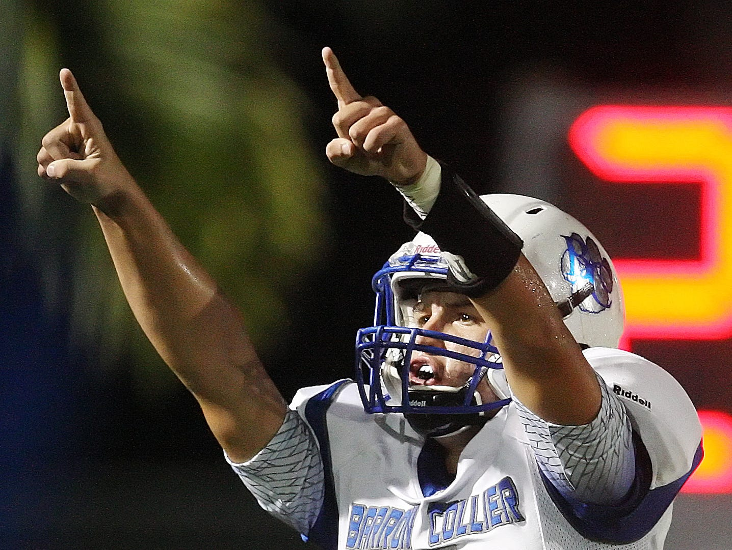 Barron Collier High School's Jack Bueldel celebrates throwing a touchdown pass Friday at Gulf Coast High School in Naples. Barron Collier beat Gulf Coast 21-15.
