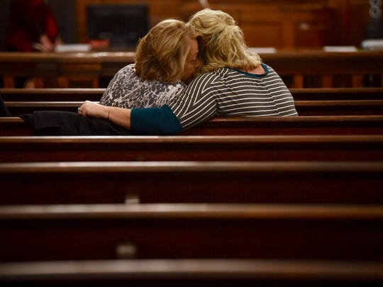 Cindy Adams whispers to a friend before the status hearing Monday, Dec. 18, 2017, of her son, John Dylan Adams, in the kidnapping, rape and killing of Holly Bobo.