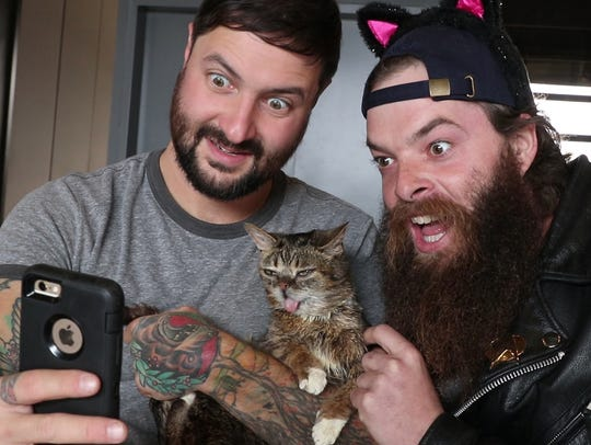 Lil Bub and his owner Mike Bridasky enjoy a meet and