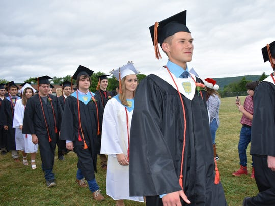 Graduates of Dover High School at the procession into