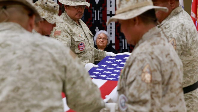The Upper Fruitland Color Guard performs a Memorial Day flag-folding ceremony for Joanne Benally in honor of her husband, Harrison Benally, a Navajo Code Talker, on May 30, 2015.