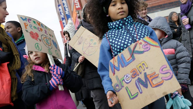 Sol-Amari Saunders, right, 7, of  Manhattan, joins a march and rally in honor of Dr. Martin Luther  King Jr., Monday, Jan. 19, 2015 in New York.