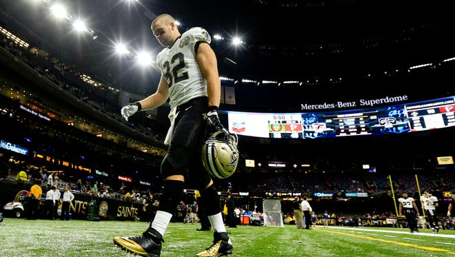 New Orleans Saints tight end Coby Fleener (82) walks off the field following a loss against the Atlanta Falcons in a game at the Mercedes-Benz Superdome.