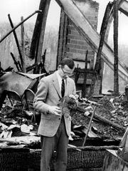 Allendale Headmaster Roger Boocock examining the destruction
