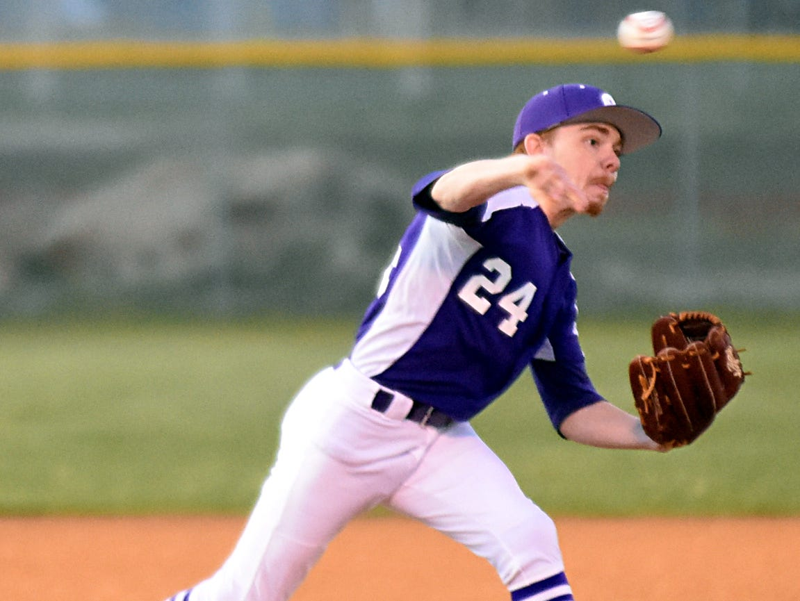 Portland High senior pitcher Austin Graves throws to first base during a second-inning pickoff attempt.