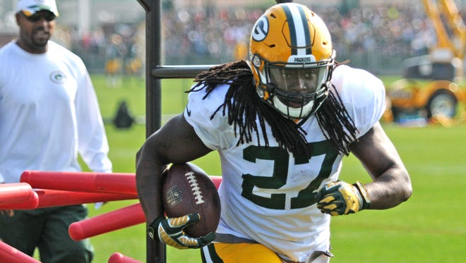 Packers running back Eddie Lacy runs through drills during Thursday's training camp practice at Ray Nitschke Field.