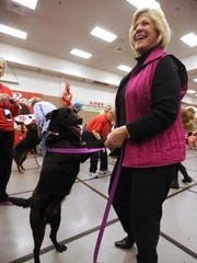 Judy Colvin boogies with her lab mix, Dixie, during the big-dog dance contest at the 16th annual Fur Ball in 2014.