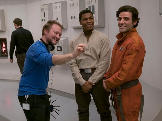 Director Rian Johnson (left) works with John Boyega