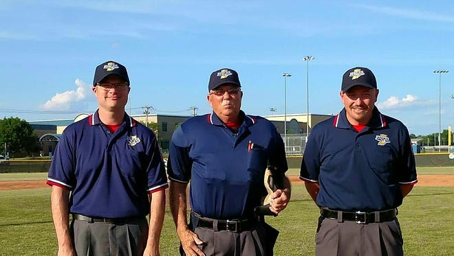 Straught High School graduate Gary Shafer, center with Dennis Goodman, left, and Brad Fisher, right, was honored as the IHSBCA District 16 Umpire of the Year for the fifth time in his 25 year career.