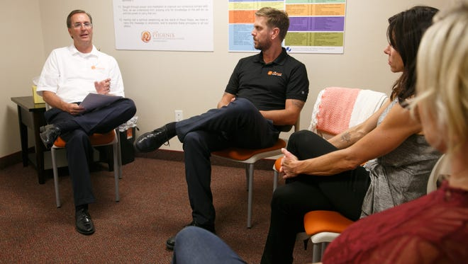 Cory Reich, left, the clinical director of the Phoenix Recovery and Counseling Centers, chats with members of the staff at the St. George offices of the addiction and mental health treatment center, Wednesday, July 26, 2016.