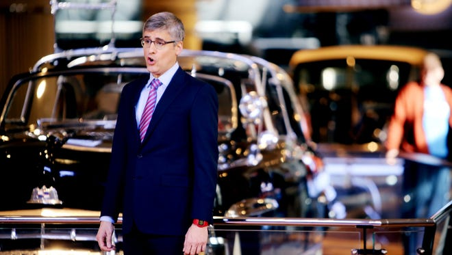 """Mo Rocca, of CBS News broadcasting is the host of """"The Henry Ford's Innovation Nation,"""" a half-hour news magazine that he is shooting new episodes of at the Dearborn museum Monday, Dec. 8, 2014 in the exhibit area where vehicles that 20th-century American presidents traveled are displayed."""