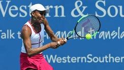 Venus Williams returns a shot against Ashleigh Barty