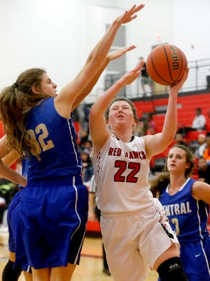 Stewarts Creek's Morgan McCrary (22) goes up for a shot as Wilson Central's Kathryn Bean (32) defends her during a recent game.