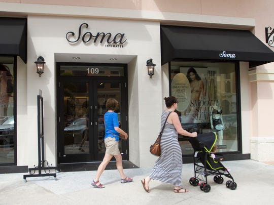 Shoppers at Coconut Point walk past the Soma Intimates store on Thursday.