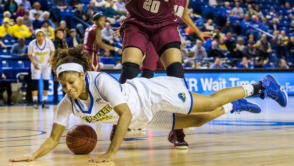 Delaware's Makeda Nicholas falls to the ground in front