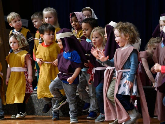 Children march out of Egypt during the children's Passover play at the Temple preschool.
