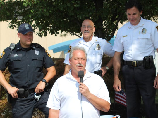 Edison Mayor Tom Lankey accepted the Ice Bucket Challenge Tuesday to raise money and awareness about ALS or Lou Gehrig's disease. Pictured left-to-right in the back are: Edison Patrolman Joe Chonka, police Capt. Andy Fresco, Police Chief Thomas Bryan and Mayor Lankey (front)
