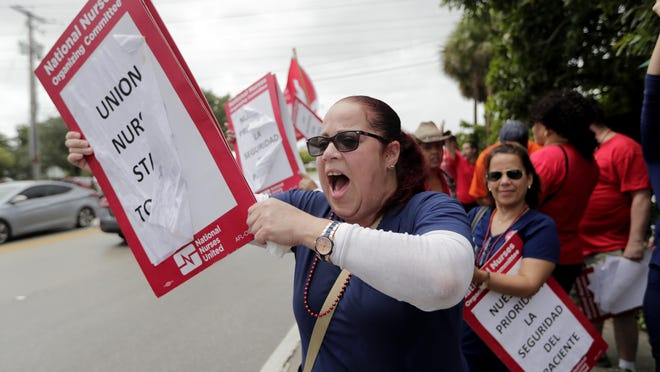 Nurse Cindy Rodriguez shouts during a one-day strike outside of Palmetto General Hospital on Friday in Hialeah. Registered nurses staged a one-day strike against Tenet Health hospitals in Florida, California and Arizona last September, demanding higher wages and better working conditions.