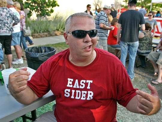 Proudly wearing his East Sider shirt, David Gibson