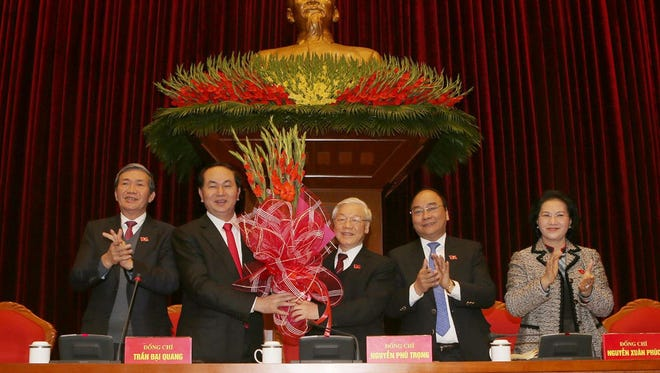Newly re-elected Vietnam Communist Party Secretary General Nguyen Phu Trong (C) wins applause at the end of the first meeting of the party's Central Committee, in Hanoi on Jan. 27, 2016.