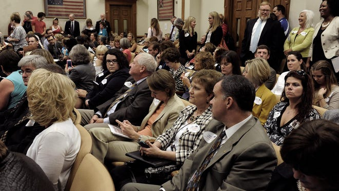 A crowd listens to a legislative hearing on the Common Core education standards Sept. 19 in Nashville. Speakers explained the standards, described as a state-led effort to provide students with critical thinking, problem solving and strong writing skills they need to help prepare them for college and global competition in the workforce.