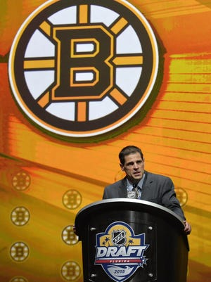 Boston Bruins general manager Don Sweeney makes the first of three consecutive draft picks in the first round of the 2015 NHL Draft at BB&T Center.