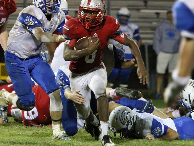 McKenzie's Eric Robinson looks for running room in a first-round playoff game vs. Riverside on Nov. 6.
