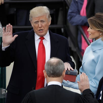 Trump takes charge, assertive but untested as president