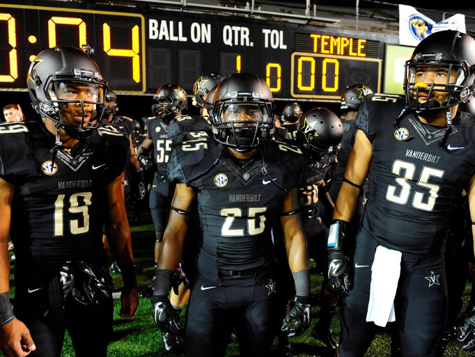 Vanderbilt Commodores players wait during a lightning delay prior to the game against the Temple Owls at Vanderbilt Stadium.