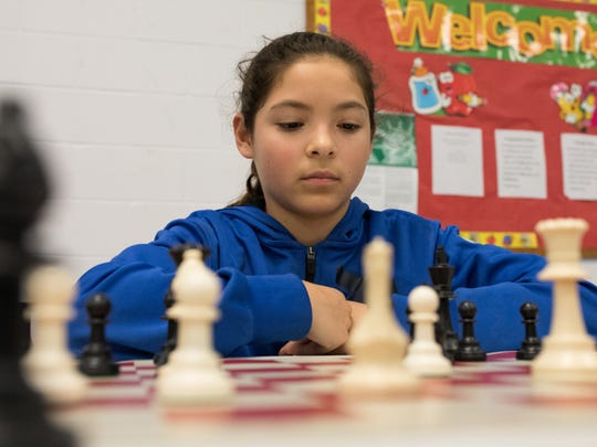 Denise Gongora, a fifth-grader who is a member of the Dr. M.L. Garza-Gonzalez Charter School chess club, practices after school on March 9, 2017.