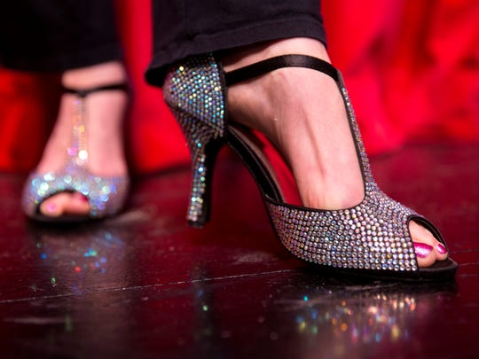 Kat Ebaugh, of Naples Players, shows off her heels for a  portrait in Sugden Community Theatre on Monday, July 24, 2017. Ebaugh is a burlesque dancer who also teaches classes on how to dance in heels.