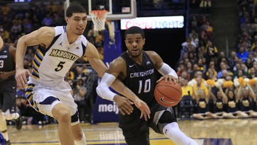 Creighton guard Maurice Watson Jr., left, drives to the basket against Marquette forward Sandy Cohen III, left, during the second half of an NCAA basketball game Saturday, Feb. 13, 2016, in Milwaukee. Creighton defeated Marquette 65-62.