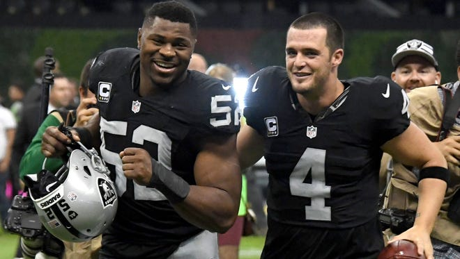 The Raiders scored big with DE Khalil Mack (52) and QB Derek Carr in the 2014 draft.