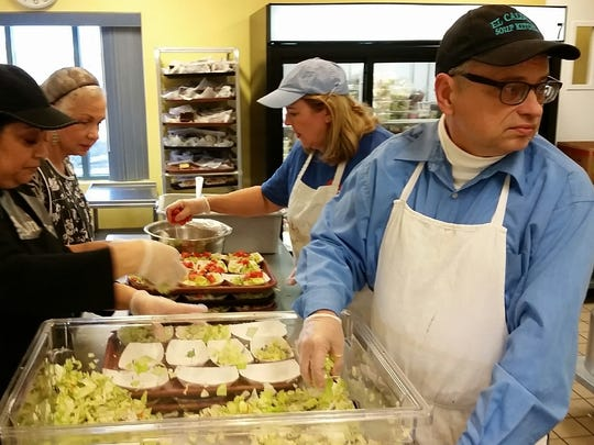 Las Crucens Jim Greene, front right, Dorothy Steiner, Lydia Evans, and Anna Montez, front left, prepare salads for the lunchtime meal served Friday at El Caldito Soup Kitchen, 999 W. Amador Ave., in Las Cruces.