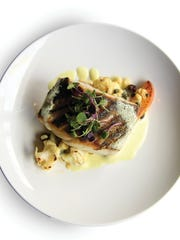 Atlantic skate wing, served with cauliflower, raisins, green apples, cucumbers, capers and a Za'atar emulsion.