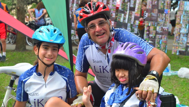 Dr. Enrique Perez with his two children, Katie and Lily. Lily, right, has Rett syndrome.