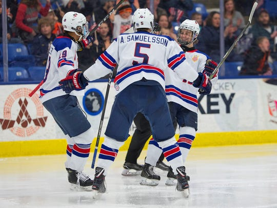 Celebrating a goal early in the third period Friday