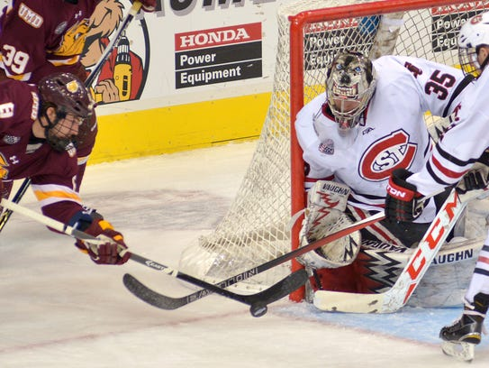 St. Cloud State goaltender Charlie Lindgren (35) protects