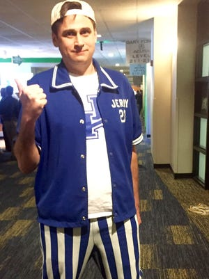 Patrick Hale, son of former Kentucky Wildcat Jerry Hale, wears his dad's warm-up tops and bottoms to the SEC Tournament each year for every game in which Kentucky plays.