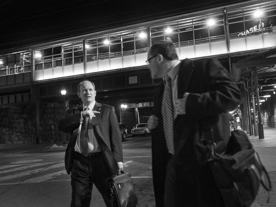 Sen. Chris Coons chats with his state press secretary Brian Cunningham at Wilmington's train station on February 25, 2014.