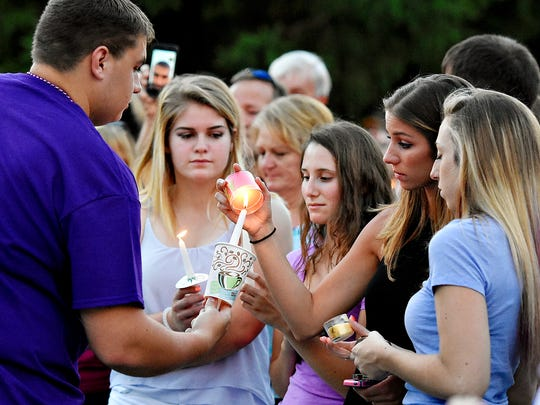 A candlelight vigil is held in honor of Amanda Kay Strous, a former Dallastown High School graduate, at her parents' home in York Township, Monday, June 20, 2016. Strous was a victim of homicide Saturday, according to police in North Carolina, where Strous currently lived. Dawn J. Sagert photo