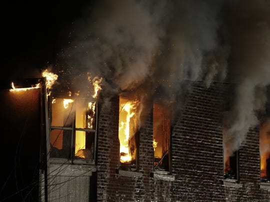 Wilmington firefighters battle a blaze in a semi-detached home on the 2200 block of Church Street, in February.