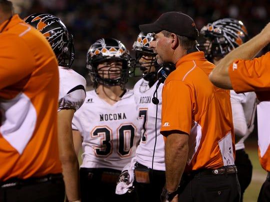 Nocona head football coach Brad Keck talks to his team