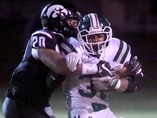Greenbrier's Brandon Chambers is wrapped up by South Side's Austin Clark during their game, Friday, November 3.