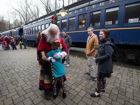 Santa meets with a child at the Wilmington & Western