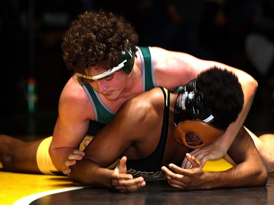South Plainfield's Luke Niemeyer (top) and Piscataway's Paris Foster wrestle in the 195 pound championship bout at the GMC Wrestling Tournament on Saturday, Jan. 27, 2018.
