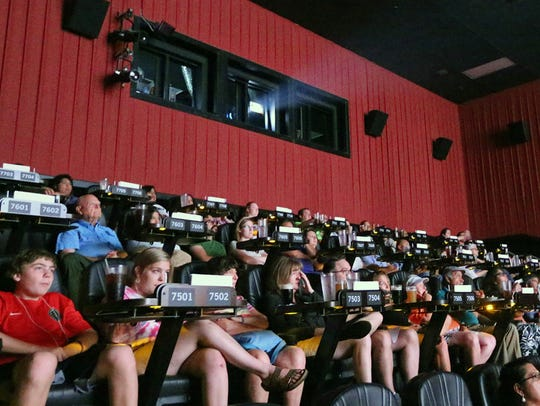 Movie goers watch the USA Today Network documentary